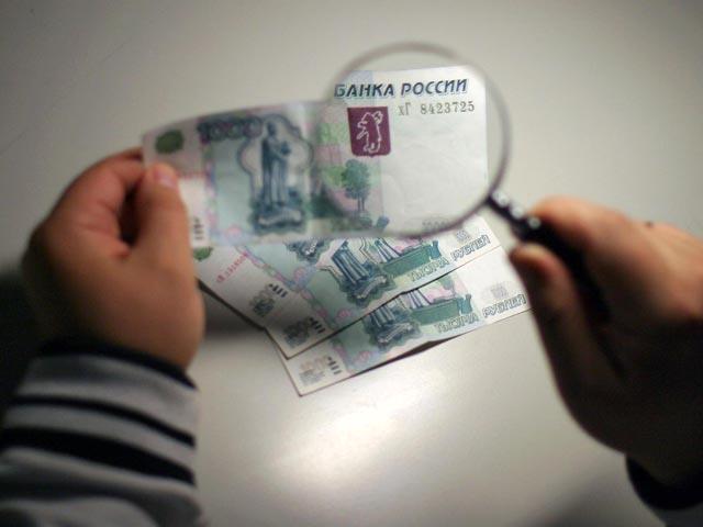 Самарские банкиры поведали, какие банкноты впервую очередь подделывали в2014г.